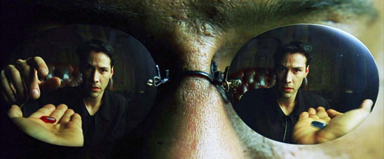 In the reflection of a black man's sunglasses, a man reaches for the red pill in one hand instead of the blue pill in the other.