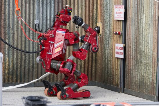 A DoD photo of a robot trying to open a door.