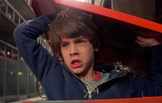 Before Sebastian runs into the book titled The Neverending Story, he is given a lecture by his dad, and jumps into a garbage bin to hide from bullies. The movie returns to both of these threads later.