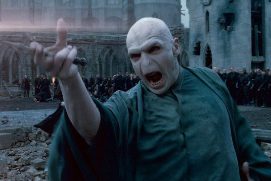 Voldemort attacks with wand.