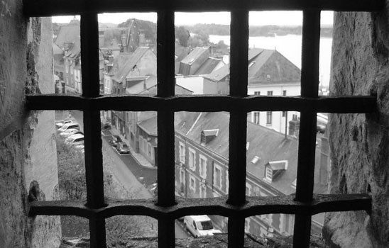 looking out a barred window