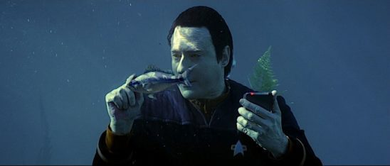 Data walking underwater with a fish.