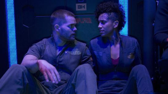 Two characters from the Expanse looking at each other.
