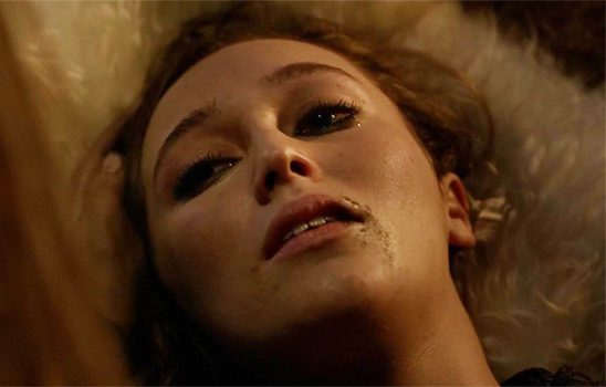Lexa lies back in bed, blood dripping from the corner of her mouth