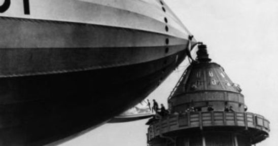 People boarding a zeppelin from the top of the Empire State Building