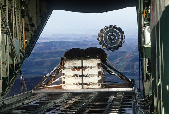 Cargo being deployed by parachute from a C-130