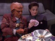 Dax and Quark play tongo, a Ferengi game.