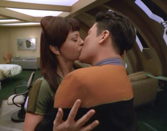Harry Kim smooching his love interest.