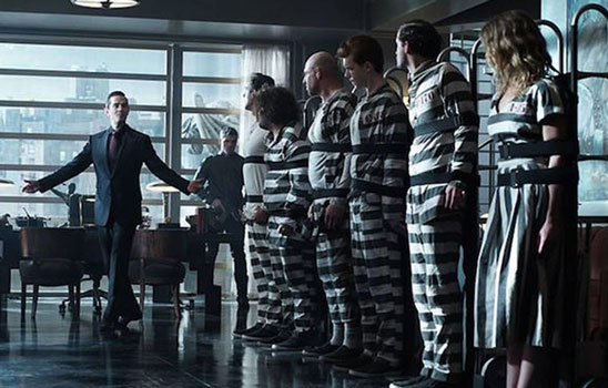 Line of villains in their Arkham Asylum stripes