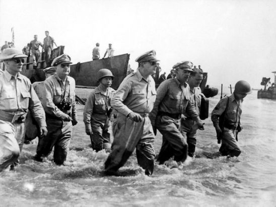 General MacArthur wading ashore.