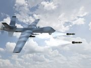 A military drone fires two missiles.