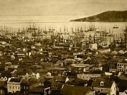 A black and white image of San Francisco harbor in 1851. The bay is full of sailing ships.