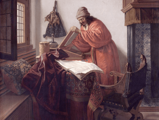 A man in an orange robe, studying a thick book.