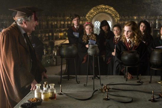 Hermione mixing a potion in class.