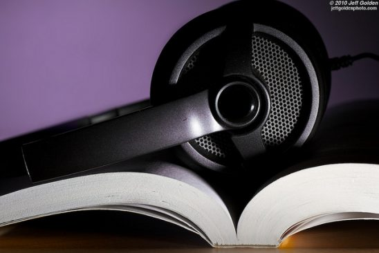 A big set of headphones on an open book.