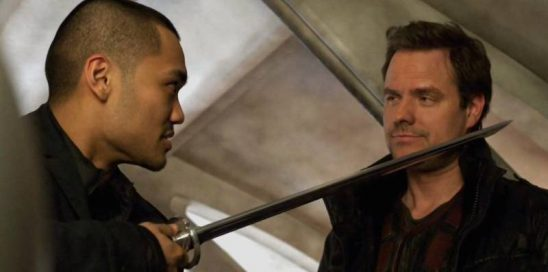 Four holding a sword to Three's throat, from Dark Matter.