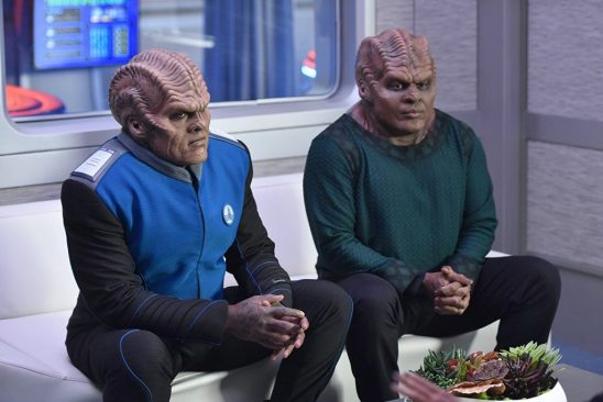 Bortus and Klyden from the Orville sitting next to each other