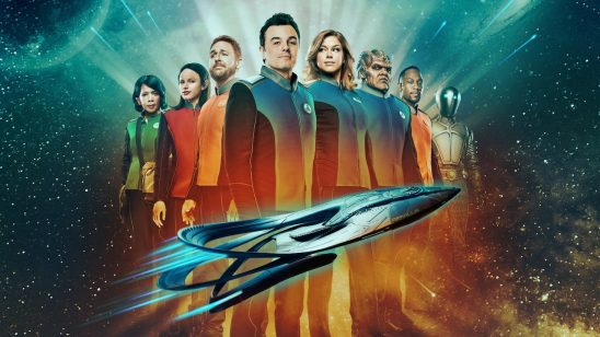 crew of The Orville posing behind their spaceship