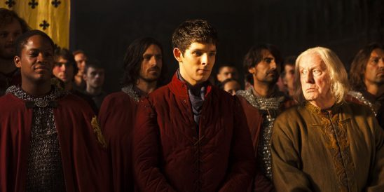 Merlin surrounded by other characters.