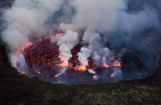 Smoking crater with cracks showing lava