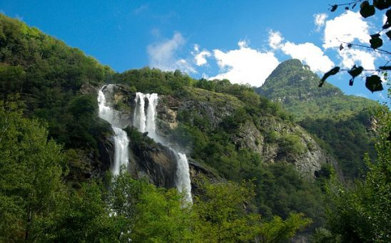 A large waterfall in green mountains.