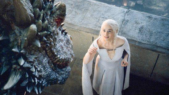 Daenerys reaching for her dragon.