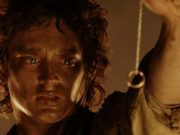 Frodo stares at the one ring in the glow of mount doom
