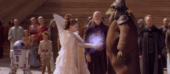 Padme giving the glowy ball of piece to Boss Nass.