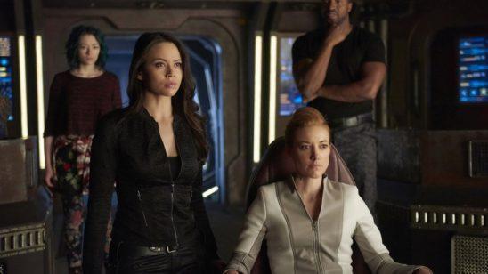 The Dark Matter characters on their bridge.