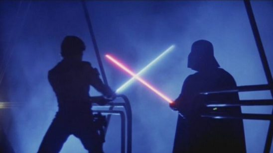 Luke and Vader clashing lightsabers.