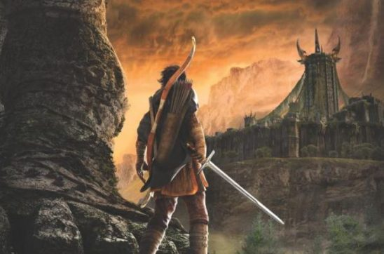 Art showing man holding sword, with a fortress in the background
