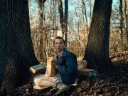 Eleven eating waffles in the woods.