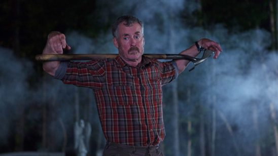Stan with a shovel over his shoulders.