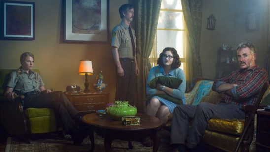The main characters of Stan Against Evil with a creepy demon in the background.