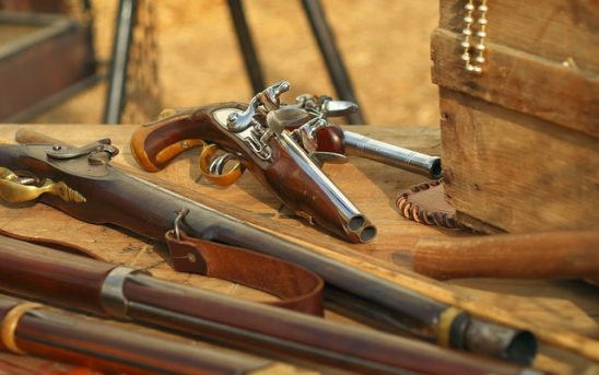 A cache of old fashioned firearms.