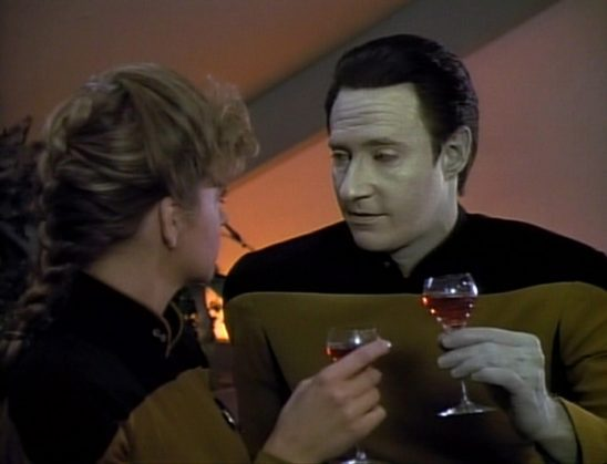 Data sharing a glass of wine with his partner in the episode In Theory.