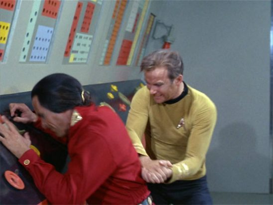 "Kirk delivering a ""double hammer fist"" to Khan's back."