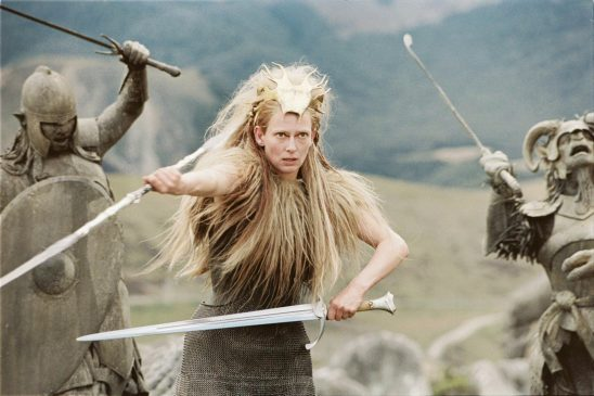 Tilda Swinton as the White Witch armed for battle with sword and wand.