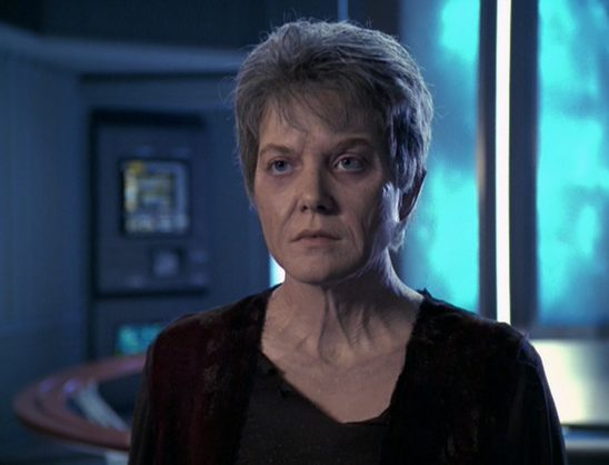 An older Kes in front of the Warp Core in Fury