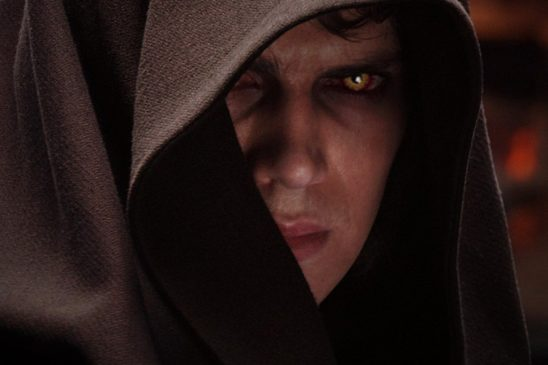 Anakin looking out from under his hood with his yellow eyes in Revenge of the Sith.