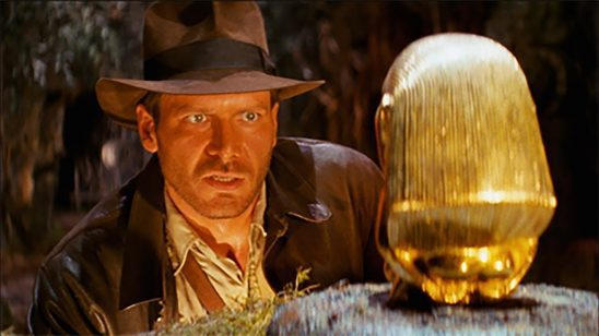 Indiana Jones staring at the idol from Raiders of the Lost Arc.