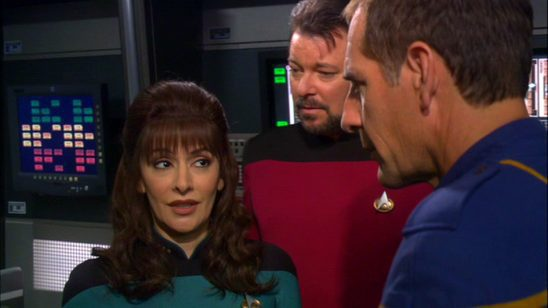 Riker and Troi looking a holographic Archer.