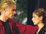 Buffy and Spike staring at each other.