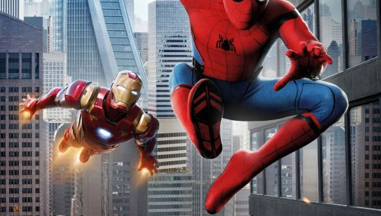 Spider-Man swinging through NYC with Iron Man flying behind him.