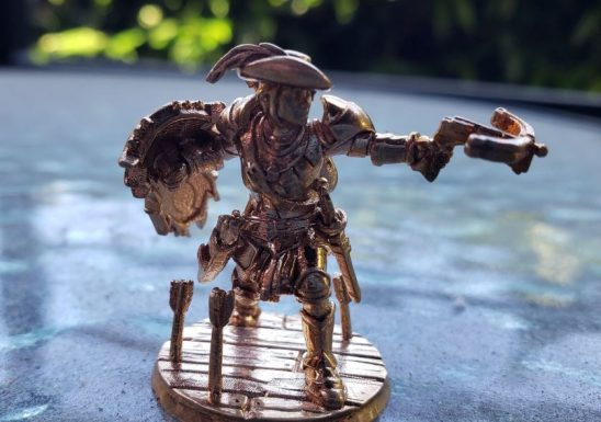 a metallic minature of a warrior with a crossbow