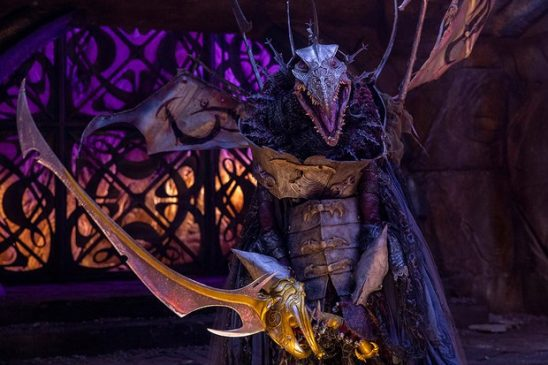 The Skeksis emperor wielding a sword.
