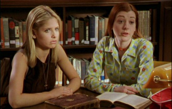 Buffy and Willow site in the school library with books