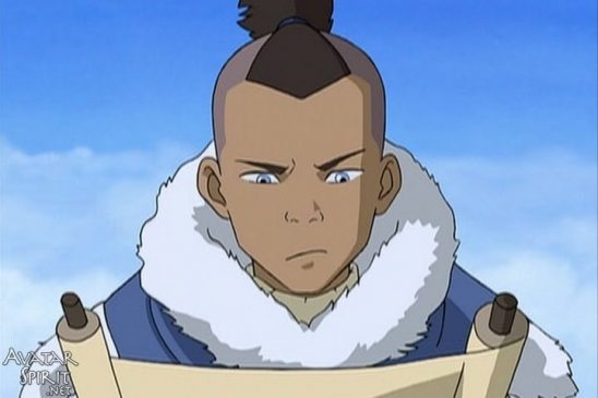 Sokka from Avatar: The Last Airbender looks intently at a scroll