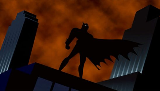 Batman standing in silhouette from the animated series.