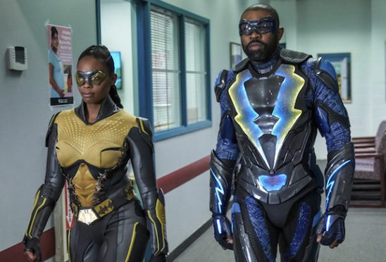 Black Lighting and his daughter, both in costume.